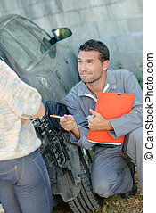 mechanic advising customer