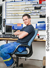 Mechanic at auto repair shop - Mechanic with arms crossed...