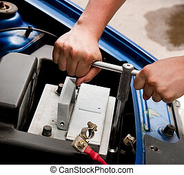Mechanic at work, process of changing the car battery, closeup shot
