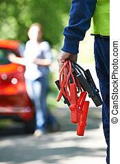 Mechanic Attending Car Breakdown On Country Road