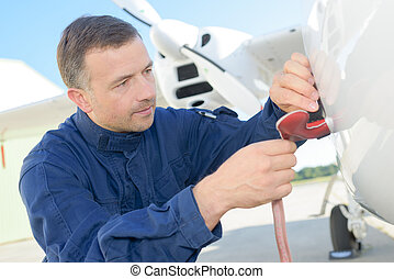 Mechanic carrying out checks on aircraft