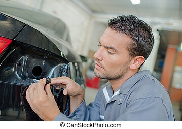 Mechanic changing a bulb