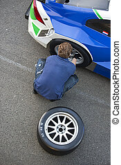 Mechanic, changing a tire - Mechanic changing a slick tire...