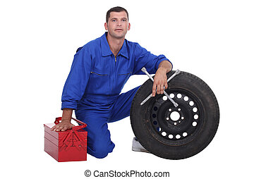 mechanic changing a tire