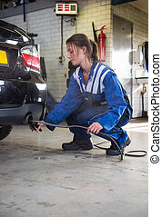 Mechanic checking diesel exhaust emission rates - young, ...