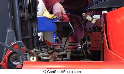 Mechanic cleaning engine - Close up of a mechanic, cleaning...