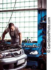 Mechanic diagnosing car engine