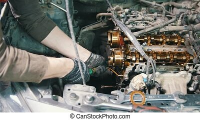 Mechanic dismantles the engine of a car, car repair, disassembly of the engine, working in the workshop