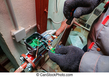 Mechanic engineer installs equipment for central heating systems, apartment building.