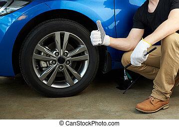 Mechanic fix car wheel. Fixed wheel on modern car