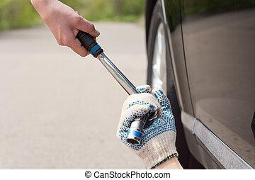 Mechanic grabbing a socket wrench