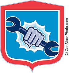 Mechanic Hand Holding Spanner Shield Punching