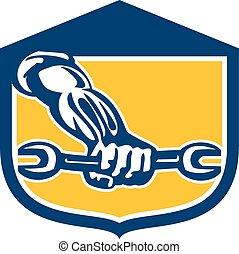 Mechanic Hand Holding Spanner Shield Retro