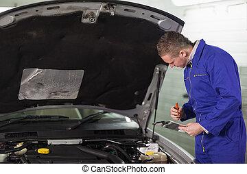 Mechanic holding a clipboard