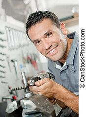 Mechanic holding drill