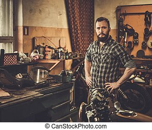 Mechanic in motorcycle custom garage