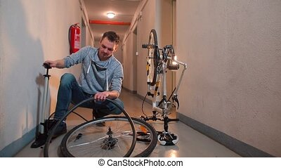 Mechanic inflate rubber from a bicycle wheel.