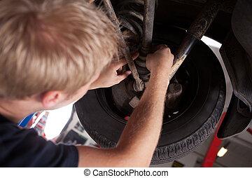 Mechanic Inspecting CV Joint