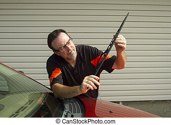 Mechanic Installing A New Wiper Blade - Mechanic installing...