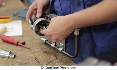Mechanic installing a trailer socket on a component