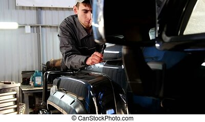 Mechanic looking to hood of the car - automobile service repairing, slider