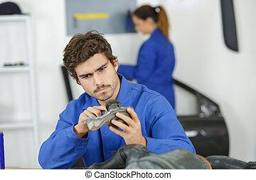 mechanic man repairing car part