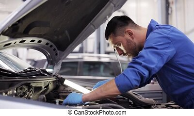 mechanic man with wrench repairing car at workshop 53 - car...