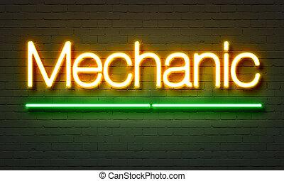 Mechanic neon sign on brick wall background.