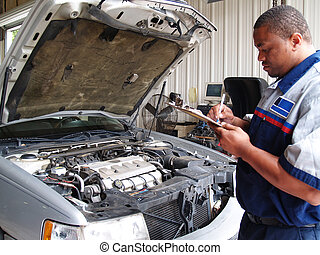 Mechanic Performing a Routine Servi