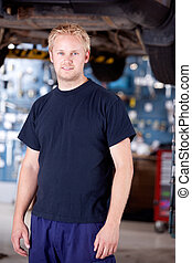Mechanic - Portrait of a mechanic looking at the camera in...