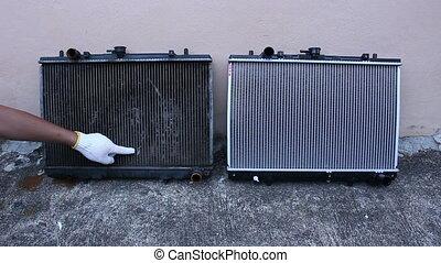 mechanic pointing radiator defective car