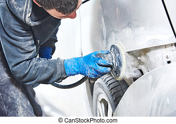 mechanic polishing car body