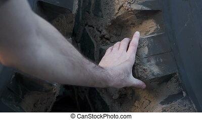 Mechanic Reaches Inspecting Tire