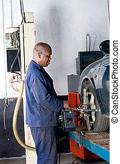 mechanic removing wheel