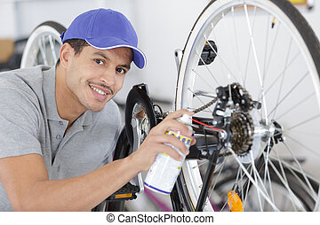 mechanic repaired bicycle in a workshop