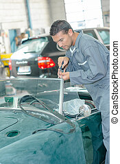 Mechanic repairing a windscreen