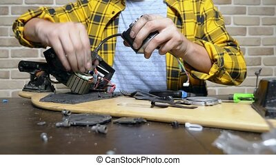 mechanic repairing an electric motor of an electric skate....