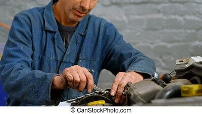 Mechanic repairing car engine 4k