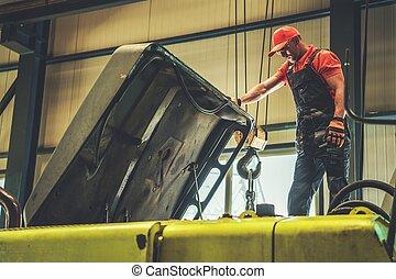 Mechanic Repairing Excavator
