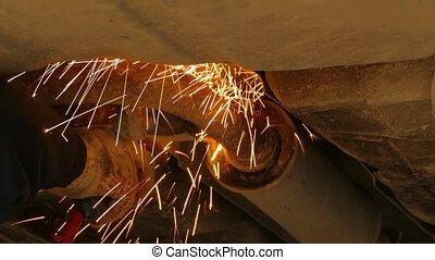 Mechanic Repairing Resonator Of Car Exhaust System
