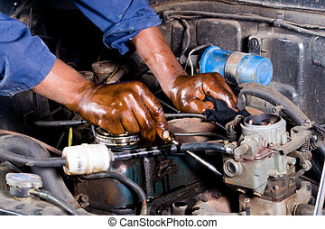 a mechanic repairing the vehicle with tools