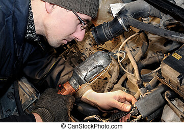 mechanic repairman at car repair work