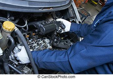 mechanic repairs a car in a garage