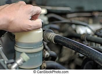 mechanic repairs checking a car