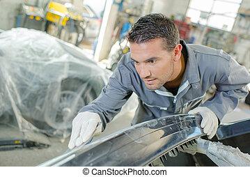 Mechanic sanding