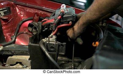 Mechanic screwing car engine mechanism. Dirty hands of car sevrice center worker