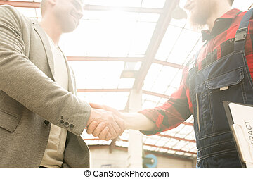 Mechanic Shaking Hands With Customer