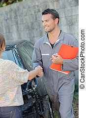 mechanic shaking hands with customer