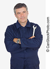 Mechanic standing with arms crossed - Portrait of confident ...