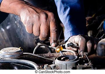 mechanic - a mechanic repairing a car